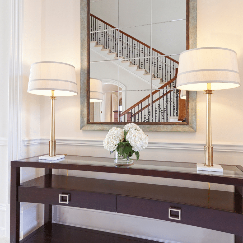 Illustrating the organization idea that a large mirror adds the illusion of space to a small entryway.